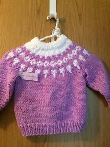 White and lavender wool sweater