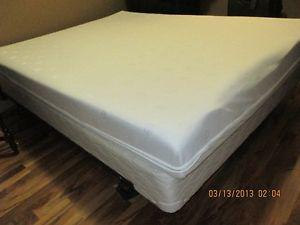 Queen size bed with metal frame on wheels - $275