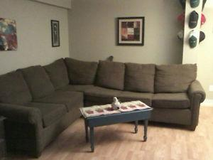 1 YEAR OLD NEW SECTIONAL WITH HIDEABED.