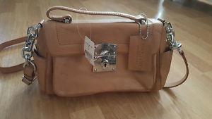 MOVING NEED GONE!BRAND NEW DANIER LEATHER PURSE TAG STILL ON