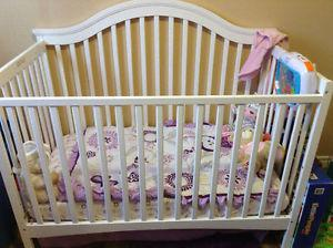White crib with mattress and bedding