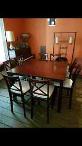 Table and 8 chairs pub style. Only 275