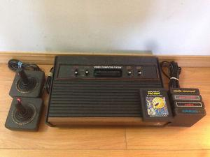 Atari  Game Console + 2 Controls + 5 Games