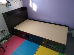 Twin bed with bookshelf and storage