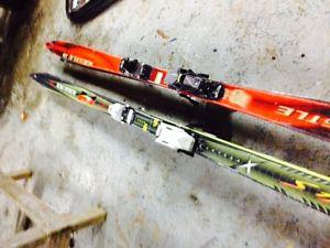 Two pairs of downhill skis