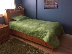 Twin bed with bookcase headboard and drawers