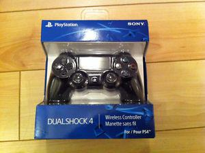 Brand new and sealed Black Dualshock 4 controller