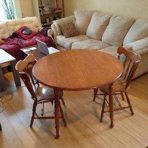 Hardwood dining table with extension and two chairs