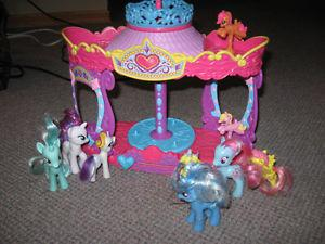 Lot of My Little Ponies with working merry go round