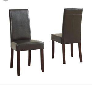 Brand new in box 2 brown faux leather parsons chairs!