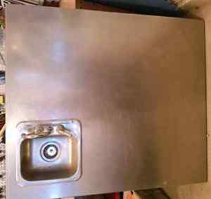 Stainless steel counter with sink