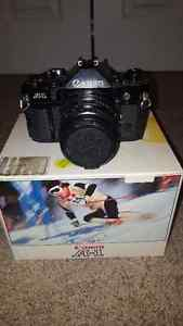 Canon A-1 35mm SLR camera 3 Lens and Accessories