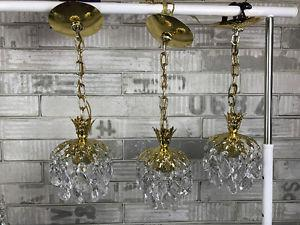 Like new set of 3 same Crystal Chandeliers $165 or best