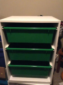 two storage units for sale - white and green