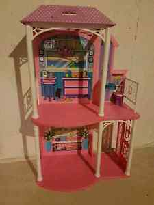 Barbie house and 3 brand new Barbie's