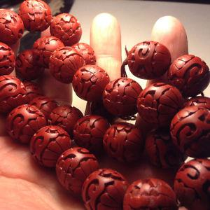 VINTAGE DECO CHINESE CARVED CINNABAR RED ROUND BEADS