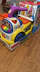 Brand new in box fisher price little people ride on