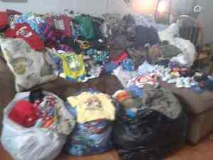 Garbage bags full of baby boy clothes!