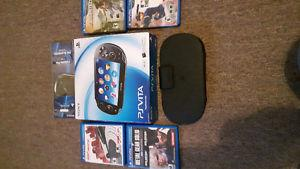 Like new Ps vita in box and 4 games