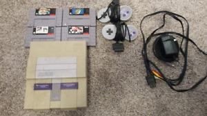 Super nintendo with four games and 2 controllers