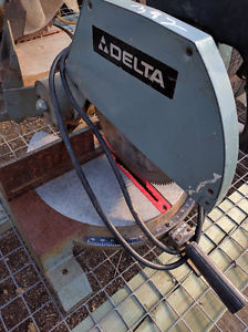 """DELTA 10"""" MITRE SAW IN SOLID SHAPE $80"""