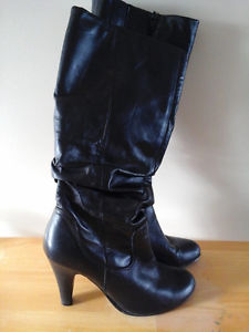 Size 9 long boots from Aldo in excellent condition,worn once
