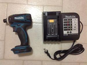 Brand new Makita impact and charger