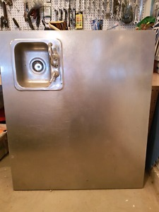 Stainless steel counter with built in sink