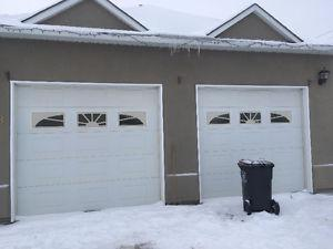 near new insulated garage doors and operner for sale
