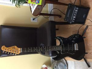 Electric guitar with amp and stand for sale!