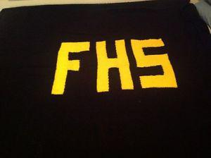 Hand knit FHS afghan black and gold. Fits queen size bed