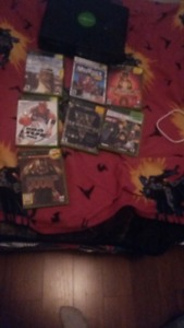Original xbox for sale with 6 games and all hook ups and
