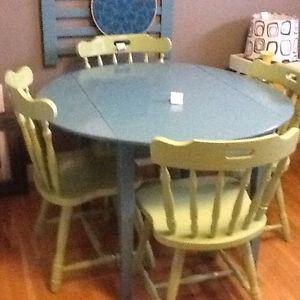 4 green chairs with blue wood table