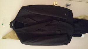 New!! Mens size  black suit. Tags attached