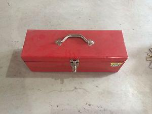 Red steel tool box with tools