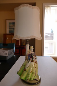 Table lamp, lady in green dress with flowers.