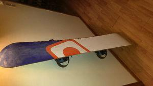 Women's snowboard with bindings and size 9 boots
