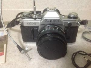 Canon AE-1 35mm SLR Film Camera with FD 50 mm lens &