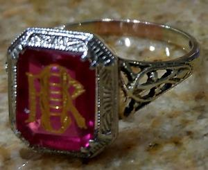 "Vintage 100 yrs. old ""Faberge"" engraved ruby on a 10k ring."