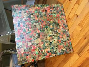 Vintage card table with stamp decoupage top