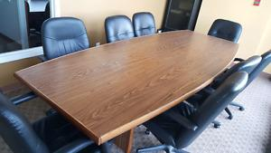 Wanted: 12 foot boardroom table with eight executive chairs