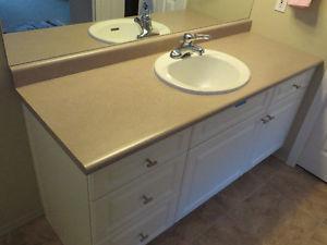 Bathroom Countertop, sink, taps and toilet