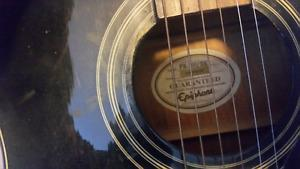 Epiphone Acoustic Guitar In great shape with think leather