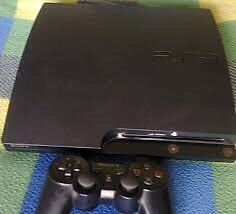 PS3 with controller and 3 games