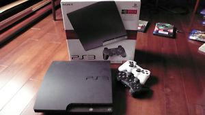 ps3 with 2 controllers and 12 games and original box/manual