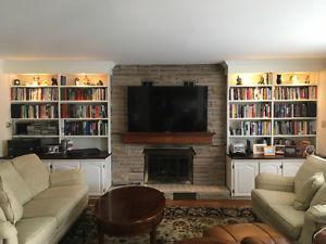 Custom bookshelves and angel stone brick for fireplace.