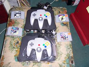 FOR SALE 2 NINTENDO,S 64s. WITH 2 GAMES,