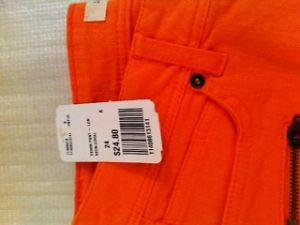 Orange pants with tag on.