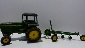 Vintage John Deere Tractor with a 4 Bottom Plow
