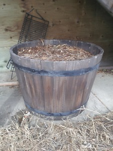 large wooden plant barrel